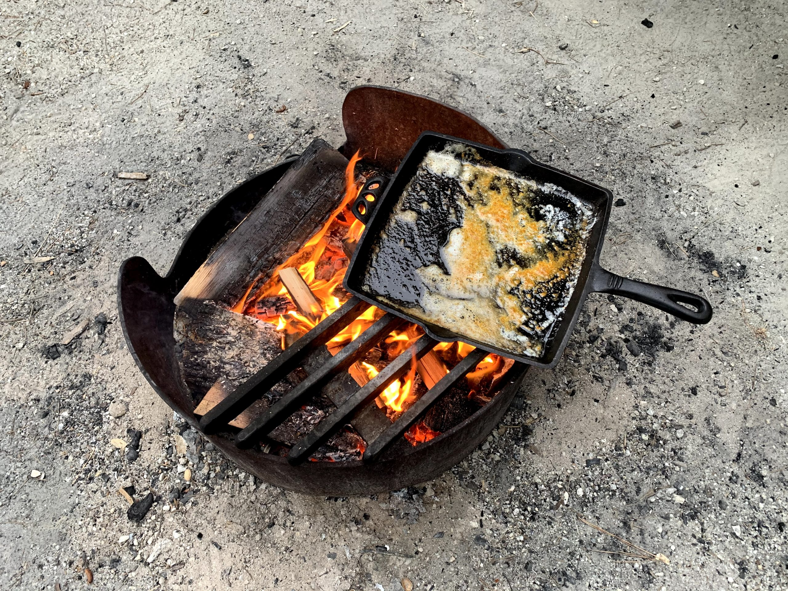 skillet with butter and seasoning